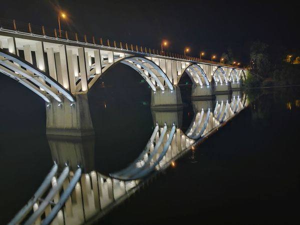 Bridge - Man Made Structure Night Connection Illuminated Reflection River Architecture Water Travel Destinations City Built Structure Outdoors No People Sky Cityscape Clock Face Barca De Alva