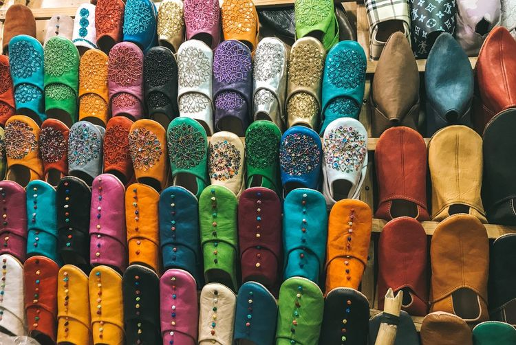 Full frame shot of multi colored shoes for sale in market
