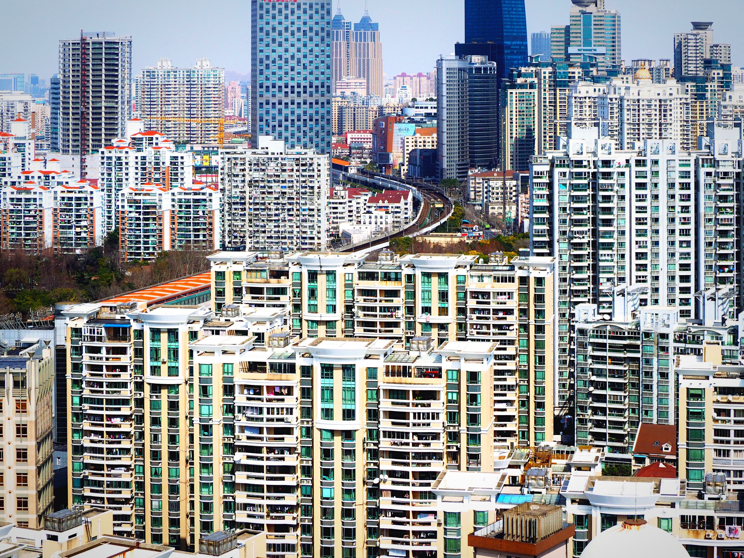 building exterior, city, architecture, built structure, skyscraper, cityscape, tall - high, modern, office building, tower, crowded, financial district, urban skyline, city life, residential building, high angle view, residential district, tall, development, capital cities
