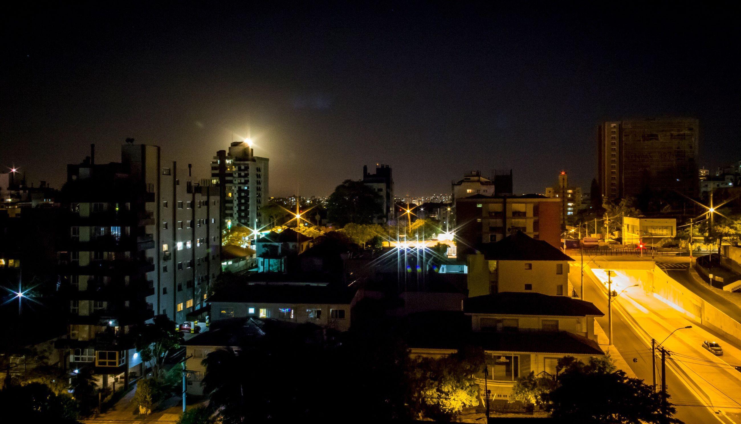illuminated, night, city, building exterior, architecture, cityscape, built structure, urban skyline, skyscraper, no people, travel destinations, sky, modern, outdoors