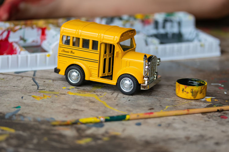 Artist Colors Creativity Activity Architecture Bus Car Close-up Colorful Container Creative Dingy Dirty Education Filthy Land Vehicle Paintbrush Painter School Toy Toy Car Transportation Unsanitary Water Colors Yellow