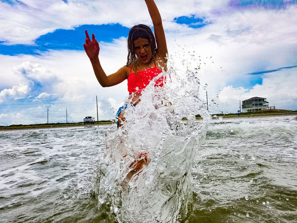 Kick Splashing Water Splashing Splash Sand Non-urban Scene Outdoors Nature Water Sealife Cloudy Beachphotography Girl Atmospheric Mood Bright Beach People And Places Beauty In Nature Sky Natural Condition Cloud - Sky