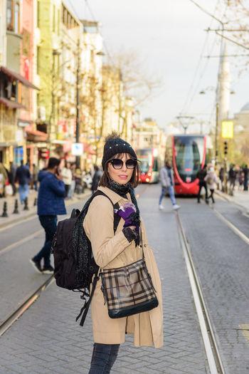 Woman Street Istanbul City People Beautiful Turkey Girl Female Urban Young Lifestyle Turkish Travel Tourist Portrait Walk Outdoor Adult Crowd Hat Europe Traveler person Holiday Vacation Walking Caucasian Tourism Public Busy Crowded Many Rail Road Tramway Metro Back Pack Backpack Bag Sunglasses Sun Glasses