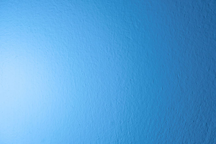 Full frame shot of blue water on wall
