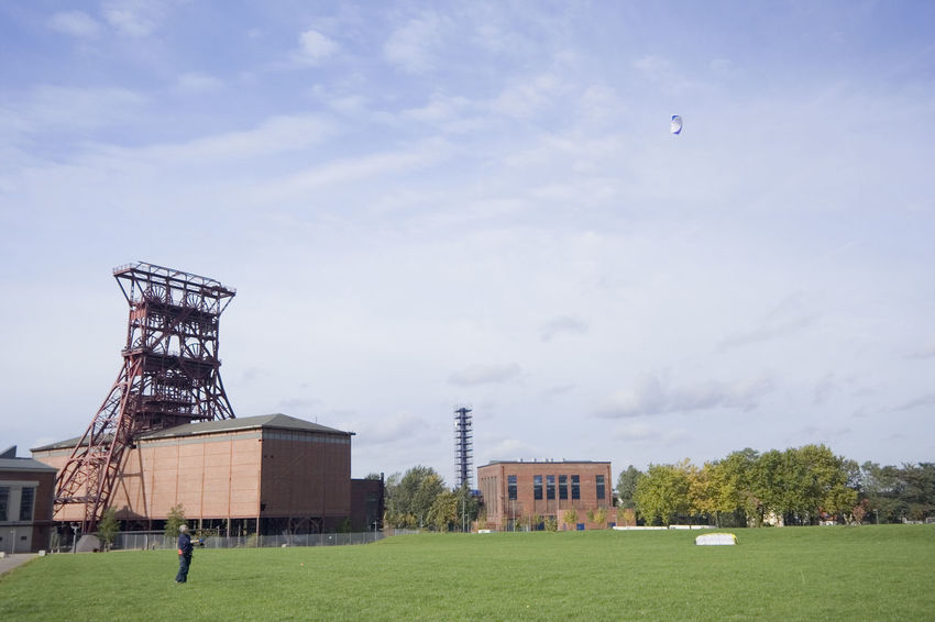 man with a power kite - action in an old industrial area with a shaft tower Architecture Building Exterior Consol Flying Flying High Fun Gelsenkirchen Germany Grass Industrial Culture Industriekultur Kite Kite Flying Leisure Activity Man NRW One Man Only Outdoors People Playing Power Kite Ruhrgebiet Shaft Tower Strukturwandel Weekend Activities