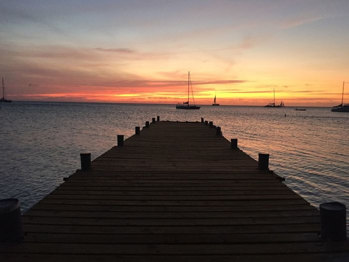 Sky Sunset Water Sea Scenics - Nature Cloud - Sky Tranquility Tranquil Scene Beauty In Nature The Way Forward Direction Horizon Pier Horizon Over Water No People Nature Orange Color Non-urban Scene Idyllic Outdoors