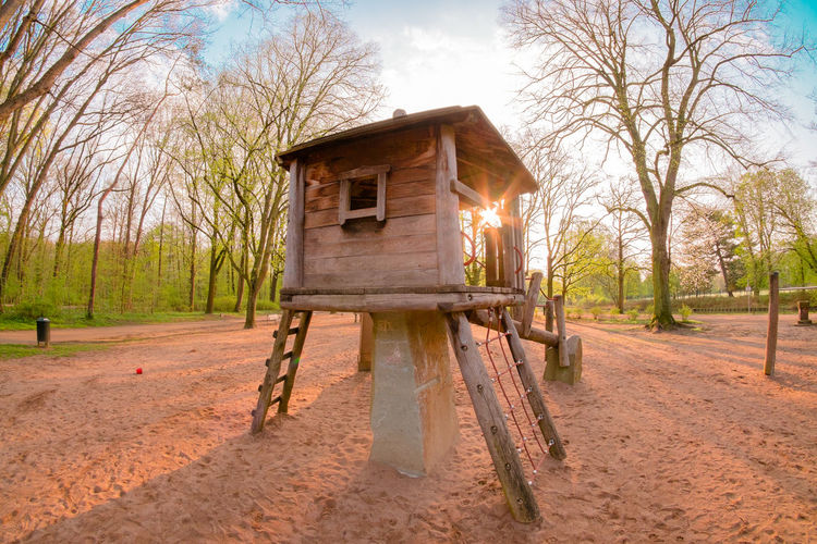 tree house on a playground in the morning sun Morning Light Sun Star Trees Architecture Building Built Structure Childhood Climbing Climbing Wall Fisheye Landscape Playground Spring Springtime Sun Beams Tree House Wood - Material