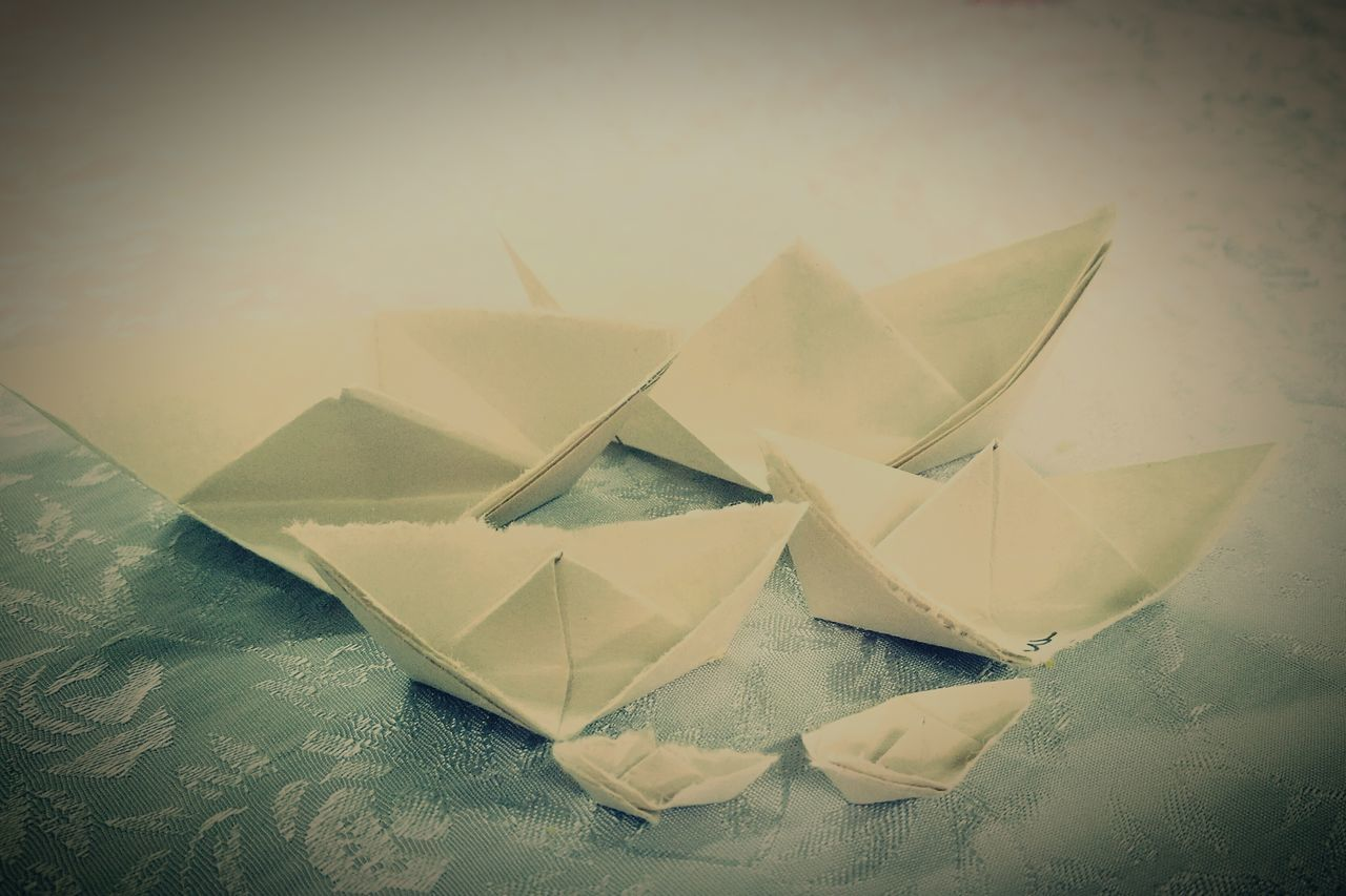 paper boat, paper, no people, indoors, day, close-up