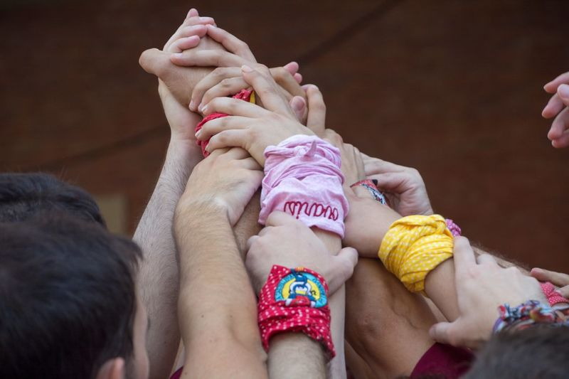 Castellers de Vilaseca building a Human Tower Human Towers Teamwork Adult All Together !!! Baby Body Part Bonding Care Castellers Castellers De Vilaseca Child Childhood Close-up Finger Give Me A Hand Group Of People Hand Human Body Part Human Foot Human Hand Human Limb Indoors  Love People Positive Emotion Real People Togetherness Women Young