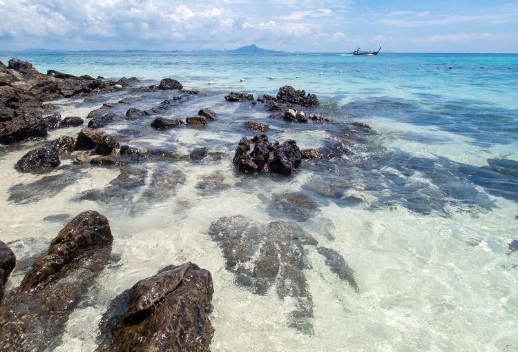 Sea Water Land Rock Beach Sky Solid Rock - Object Horizon Horizon Over Water Scenics - Nature Nature Beauty In Nature Cloud - Sky No People Motion Day Tranquility Sport Outdoors Marine
