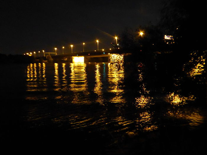 Nachtlichtreflexionen auf der Donau Memories ❤ Beauty In Nature Simple Beauty Simple Photography For My Friends🙄🙋♀️ Exceptional Photographs EyeEm Best Shots Reflections On The River Golden Water Vienna❤ Nightlights Reflections Danube By Night Water Illuminated Sea Reflection