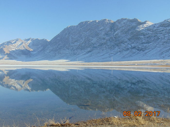 Lake from Batken / Kyrgyzstan BATKEN Beauty In Nature Clear Sky Communication Day Environment Lake Lake From Batken/Kyrgyzstan Landscape Mountain Mountain Range Nature No People Outdoors Scenics - Nature Sign Sky Tranquil Scene Tranquility Transparent Water Water Winter From Batken Winter Wonderland