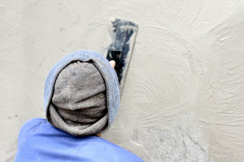 Man plastering concrete wall Wall Worker Cement Concrete Concrete Wall Day One Person Plaster Plastering Plastering Worker Smooth Wall Construction Wall Plaster