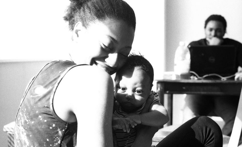 """""""Zaheer"""" by Kesi J. Marcus Bonding Boys Childhood Close-up Day Family Film Photography Focus On Foreground Girls Happiness Indoors  Leisure Activity Lifestyles Love Newborn Real People Sitting Togetherness Two People Young Adult Young Women"""