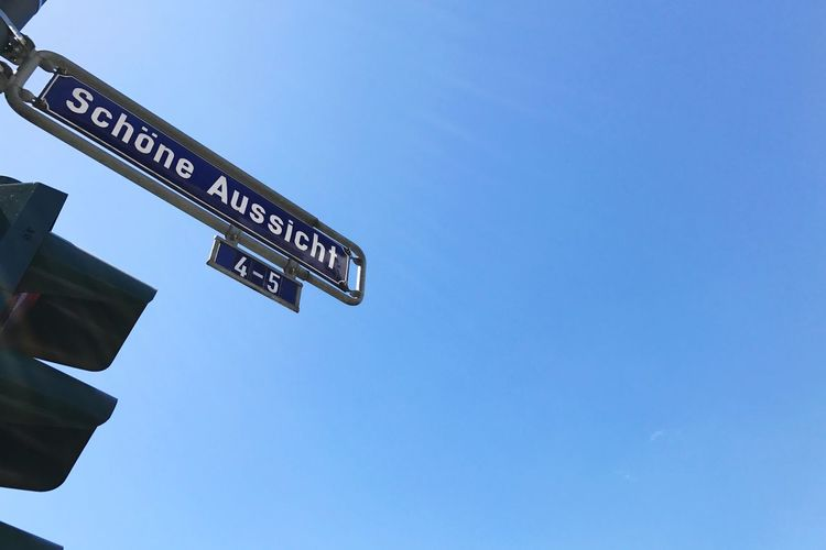 Frankfurt Am Main Schöne Aussicht  Western Script Text Low Angle View Guidance Communication Direction Road Sign Clear Sky Day Copy Space Street Name Sign Outdoors Architecture Built Structure Sky No People Blue