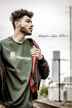 The Fashion Photographer - 2018 EyeEm Awards Adult Beard Casual Clothing Day Emotion Focus On Foreground Front View Hairstyle Lifestyles Looking Looking Away One Person Real People Standing Waist Up Young Adult Young Men