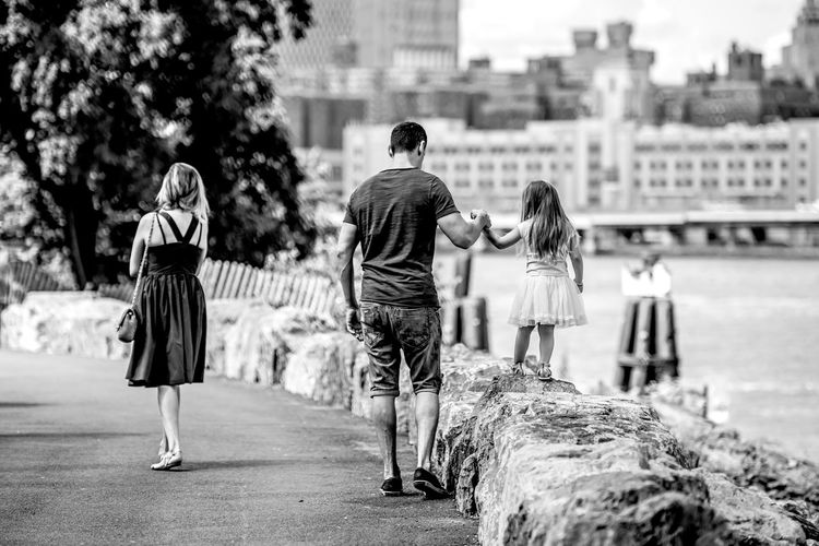 """""""Guided by Daddy"""" Street Life Streetphotography Building Exterior Day Focus On Foreground Friendship Full Length Human Hand Lifestyles Men People Real People Rear View Togetherness Street EyeEm Best Shots EyeEm Best Shots - Black + White EyeEmNewHere EyeEmBestPics Family Eyeemphotography Leisure Activity City Casual Clothing City Life Nikon Stories From The City This Is Family The Street Photographer - 2018 EyeEm Awards The Art Of Street Photography My Best Photo"""