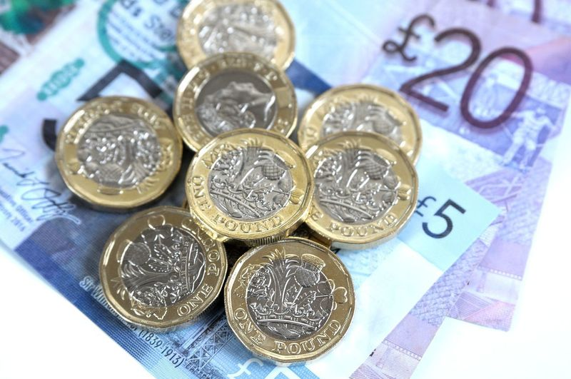 Sterling Banking Blue British Currency Business Close-up Coin Currency Economy Finance High Angle View Indoors  Investment Metal No People Number Paper Currency Pound Coin 2017 Savings Silver Colored Still Life Wealth