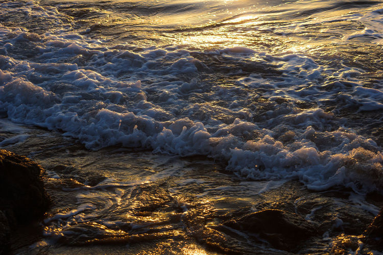 evening at beach Water Sea Aquatic Sport Beauty In Nature Surfing Wave Sport Motion Nature Land Beach Day High Angle View Full Frame Outdoors Rock Rushing Sunlight Power In Nature Flowing Water Breaking Flowing