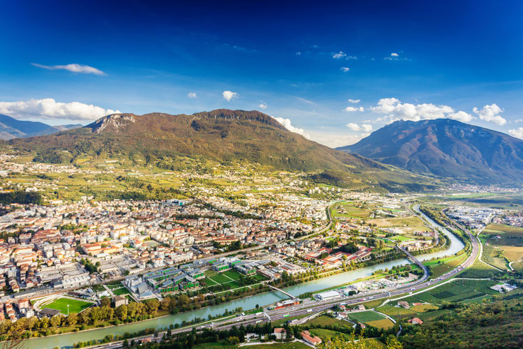 High angle view of townscape of trento against sky