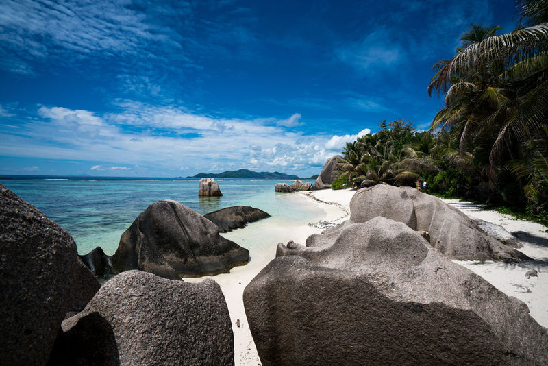 Anse Source d'Argent beach in La Digue island in The Seychelles Africa Anse Source D'argent Beach Beauty In Nature Blue Cloud - Sky Day Horizon Over Water La Digue Nature No People Outdoors Rock - Object Scenics Sea Seychelles Sky Tranquil Scene Tranquility Tree Water