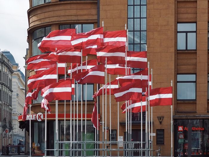 Low angle view of flag against buildings in city