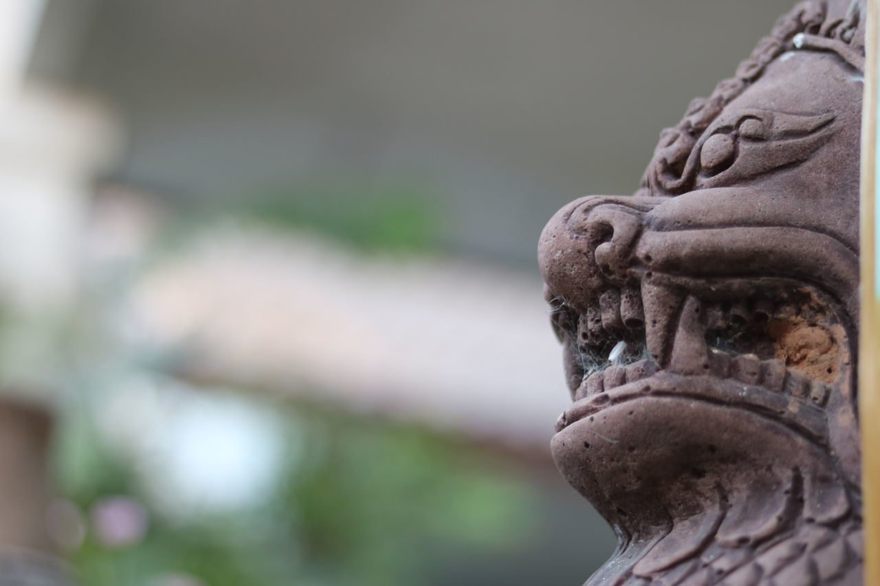 sculpture, representation, art and craft, statue, focus on foreground, close-up, creativity, craft, human representation, no people, day, male likeness, old, religion, spirituality, architecture, outdoors, history, carving - craft product