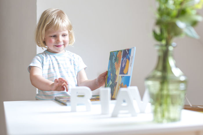 2 3 Alphabet At Home Blonde Book Child Childhood Cute Domestic Room Education Girl Home Illustration Lifestyles Portrait Read Relaxing Selective Focus Smile Toddler