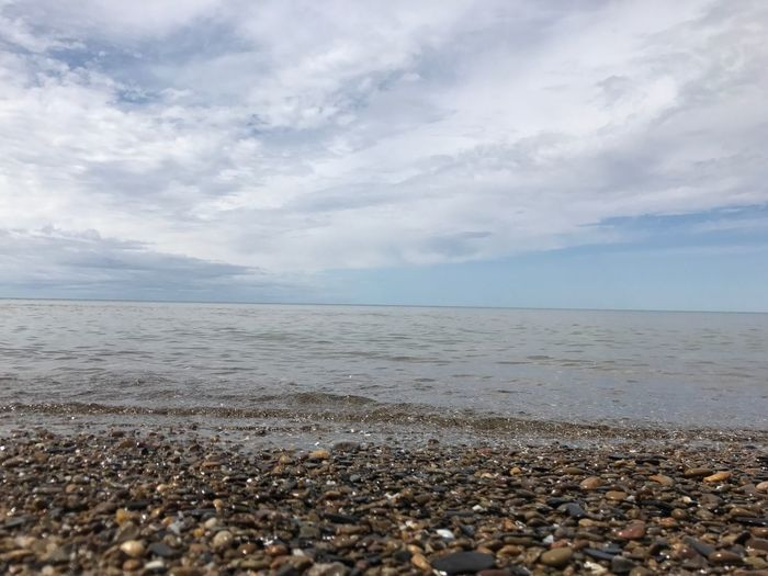 Sea Beach Horizon Over Water Water Tranquil Scene Tranquility Shore Beauty In Nature Scenics Nature Pebble Sky Cloud - Sky Pebble Beach Day Idyllic Sand No People Outdoors Myshotsmyphotography Loveforphotography Eye4photography