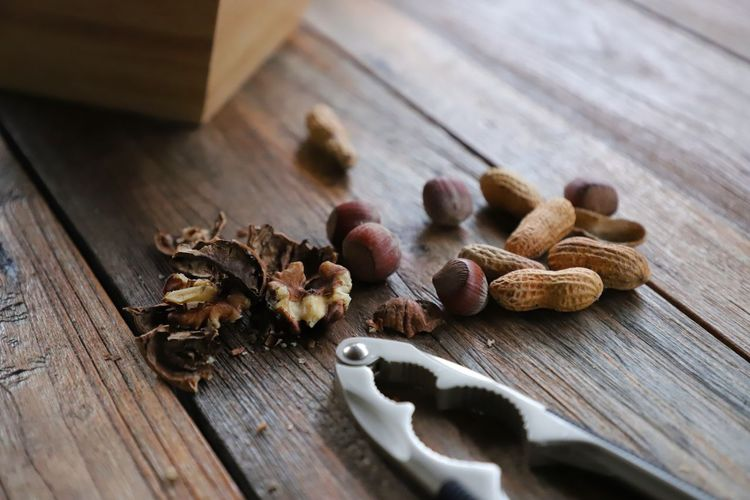 Food And Drink Nutcracker Nuts Peanuts Wintertime Brown Close-up Day Food Food And Drink Foodporn Freshness Hazelnut Healthy Healthy Eating Indoors  No People Nut On The Table Peanut Selective Focus Still Life Table Walnut Wood - Material