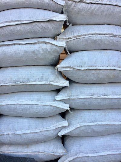 Full frame shot of stack of sacks