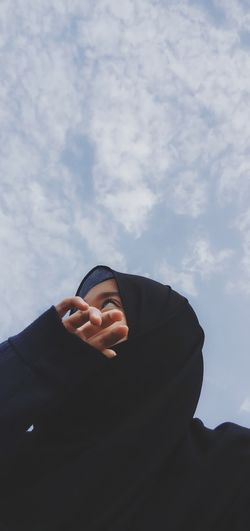 Low angle view of person against sky