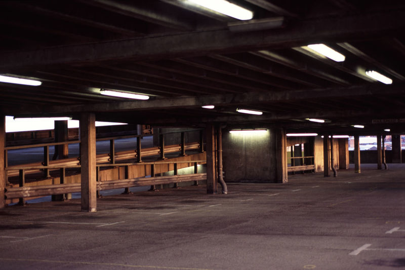 interior of a multistory carpark Built Structure Carpark Concrete Deck Decking Empty Flourescent Lights Multistory Neon