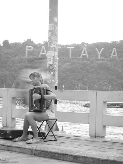 black and white photography of blind girl musician BaliHai Pattaya Thailand Vacation Time Blinds Candid Photography Lifes Lifestyle Photography Musician Outdoors Storytellingphotography Streetphotography