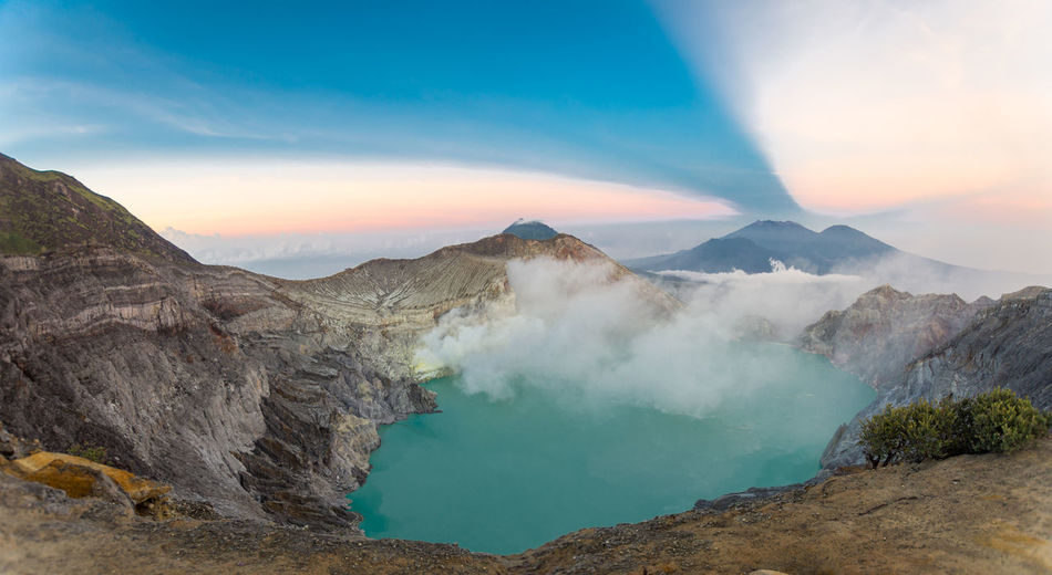 INDONESIA Beauty In Nature Cloud - Sky Environment Geology Kawah Ijen Land Landscape Mountain Nature No People Non-urban Scene Outdoors Physical Geography Power In Nature Rock Scenics - Nature Sky Smoke - Physical Structure Sunset Tranquil Scene Tranquility Volcanic Crater Volcano Water