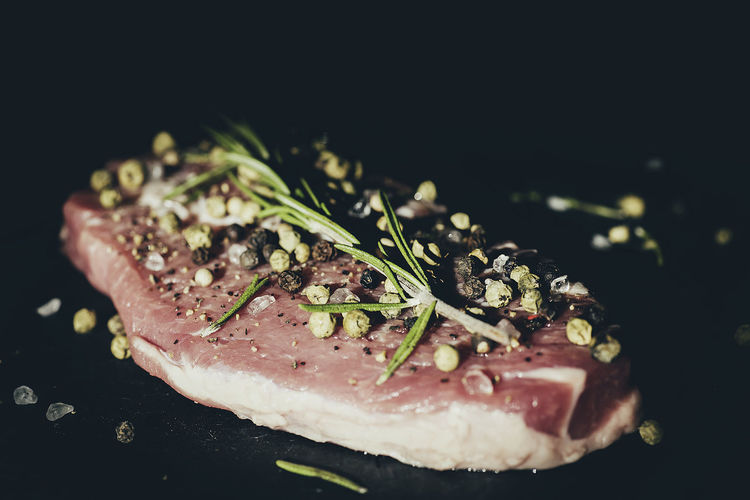 Pork with thyme and pepper Keto Meal Pork Black Background Close-up Day Food Food And Drink Foodphotography Foodprep Freshness Harsh Light Healthy Eating Mealprep Meat No People Pepper Protein Raw Food Thyme