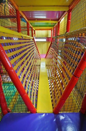 Fun Kids Playing Rainbow Colors Red Colorful Game Indoors  Multi Colored No People Plank Playground Playhouse Yellow