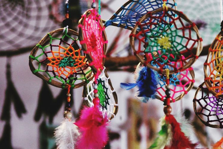 Close-Up Of Colorful Dreamcathchers Hanging For Sale At Market