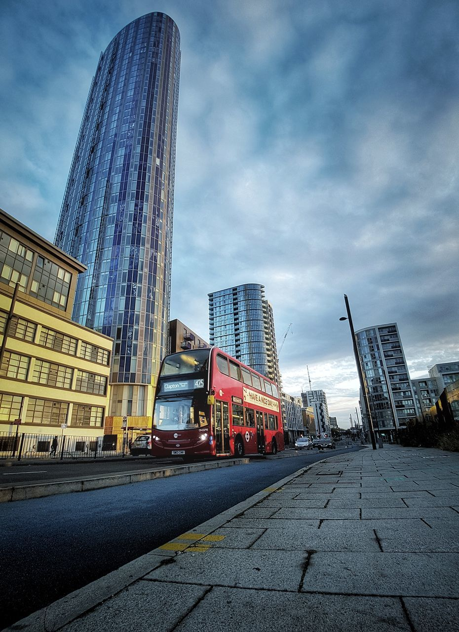 architecture, building exterior, built structure, sky, skyscraper, city, cloud - sky, transportation, day, outdoors, no people, modern