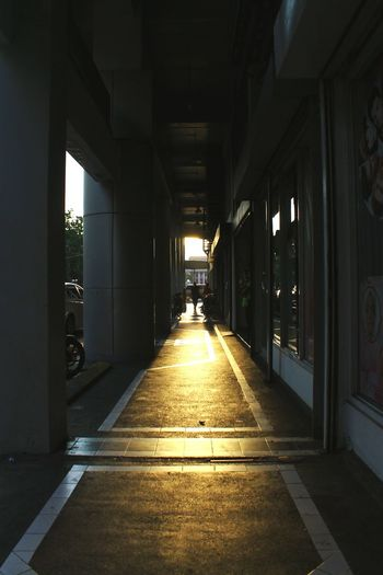 Sunlight Falling In Colonnade By Shops