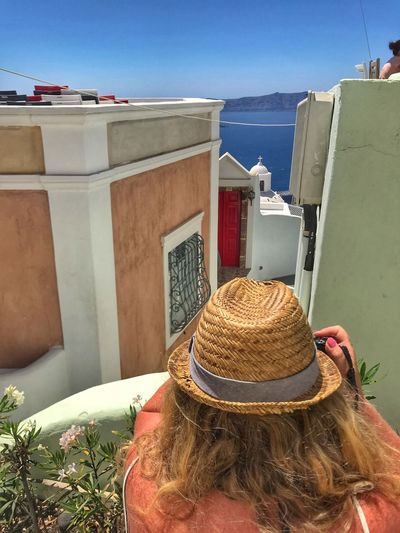 The woman with the hat, the photographer Built Structure Architecture Hat Building Exterior Nature Day Sky Water Clothing Sea Sunlight One Person City Building Outdoors Real People Lifestyles
