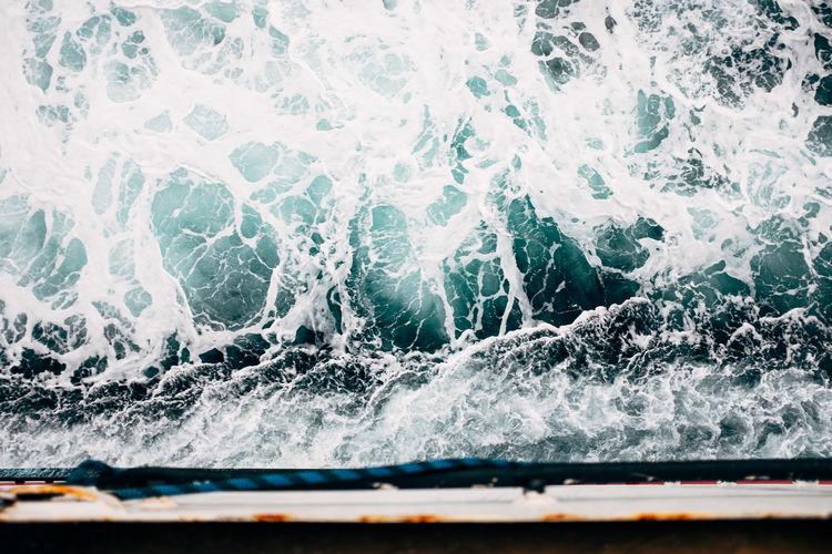 Sea waves splashing on boat