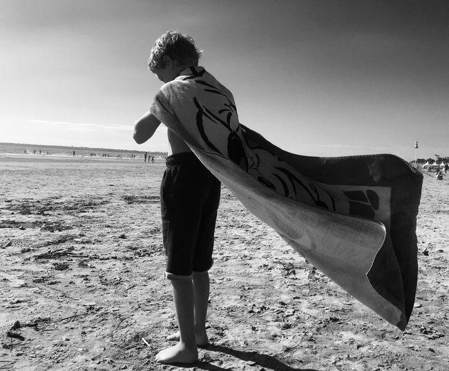 Full Length Of Boy Standing On Beach
