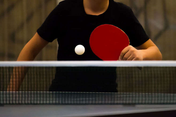 Adult Ball Competition Competitive Sport Day Go-west-photography.com Holding Human Hand Indoor Sports Indoors  Indoors  Leisure Activity Lifestyles Midsection Net Net - Sports Equipment One Person People Playing Racket Racket Sport Real People Skill  Sport Table Tennis Table Tennis Tabletennis