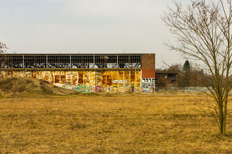 Graffiti on abandoned building against clear sky