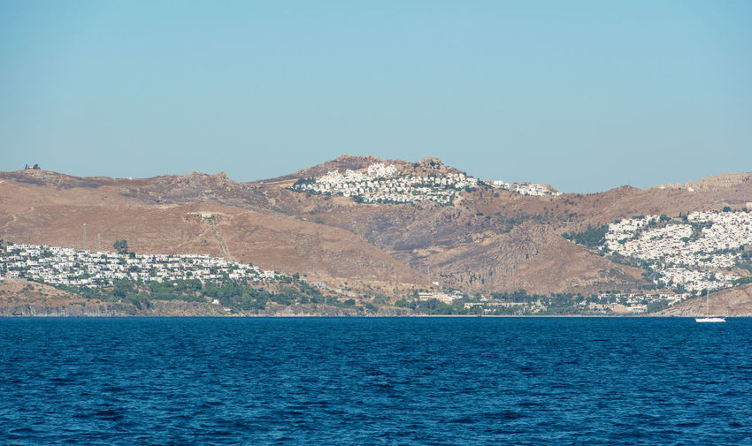 Aegean sea turkish coast and view of the port city of bodrum, boat trip from kos city to bodrum