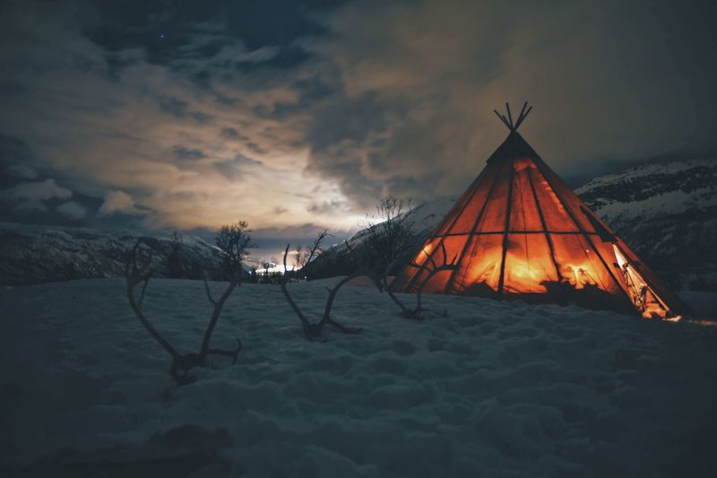 Tent on snow covered landscape