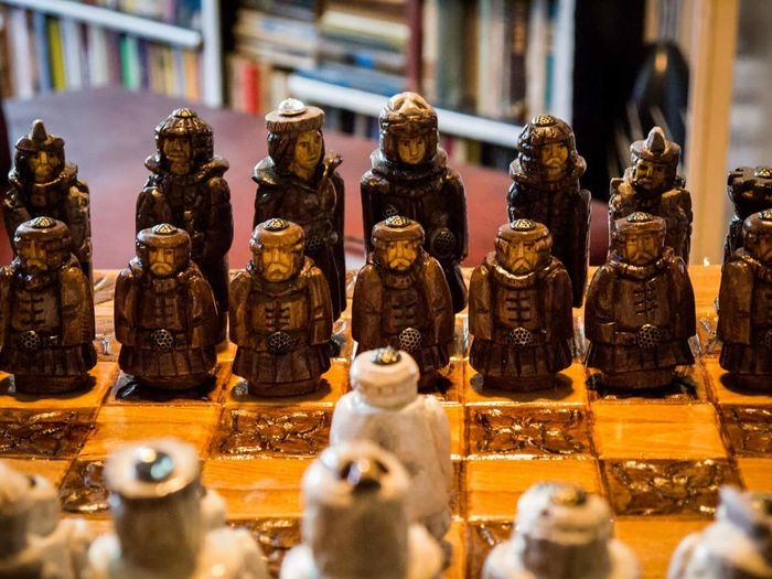 High angle view of figurines on chess board