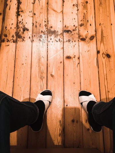 'one step at the time, or maybe two?' Socks And Sandals Sandals Human Body Part Wood - Material Low Section Body Part Standing Lifestyles Real People Human Leg Shoe One Person Wood Human Limb Shadow Limb Adult Personal Perspective Flooring Human Foot Day