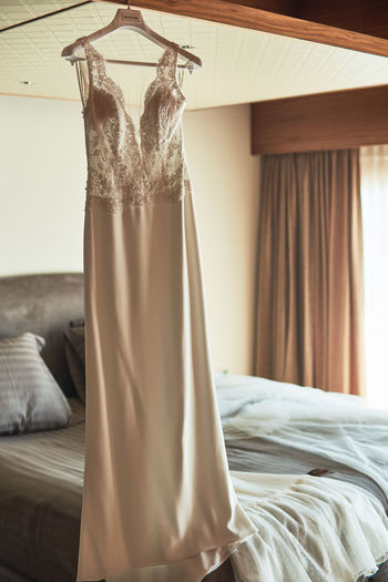 Dress hanging in bedroom at home
